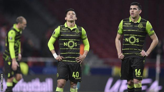 Sporting Lisbon players look dejected after defeat by Atletico Madrid