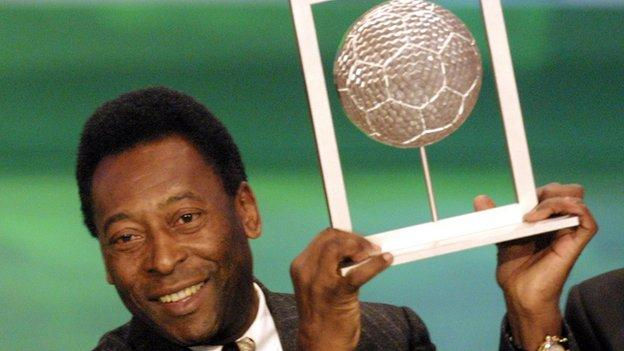 Pele holds his player of the century award