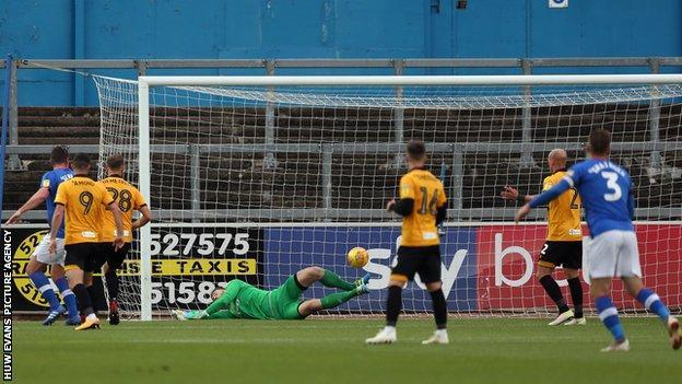 Jamie Devitt curls in Carlisle's second goal