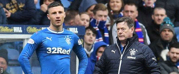 Michael O'Halloran prepares to play off the bench for Rangers