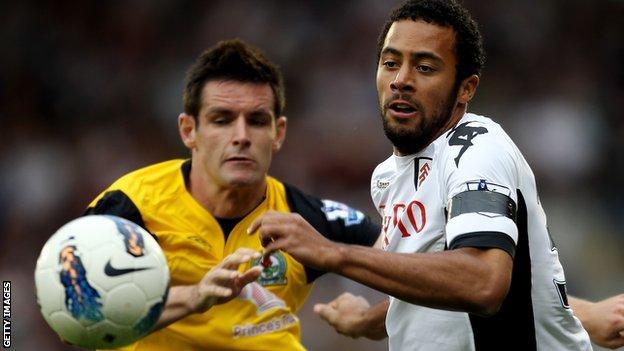 Mousa Dembele takes on Ryan Nelsen