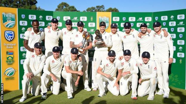 England celebrate with the Basil D'Oliveira Trophy after the Test series