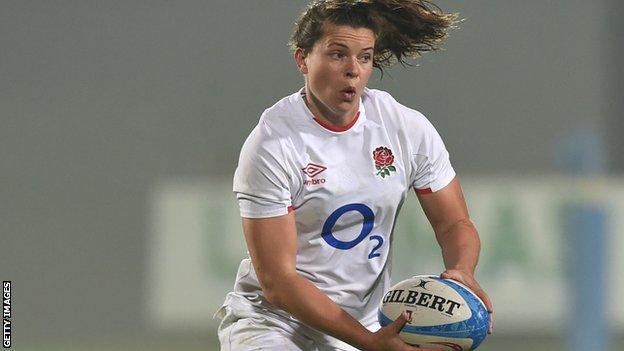 Abbie Ward runs with the ball