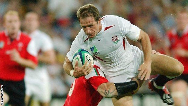 Mike Catt is tackled during England's win over Wales in the 2003 World Cup quarter final