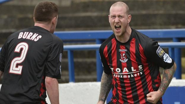 Stephen O'Flynn celebrates equalising late on for Crusaders, who managed to clinch a draw despite being reduced to nine players against the Bannsiders