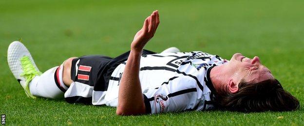 Dunfermline's Joe Cardle lies injured