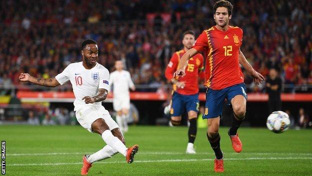 Raheem Sterling scores the opening goal for England against Spain