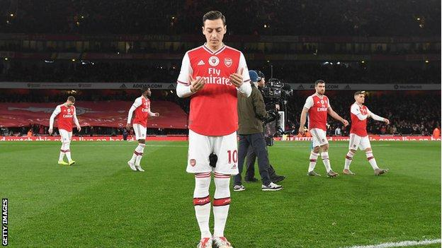 Mesut Ozil prays before Arsenal's game against Manchester City