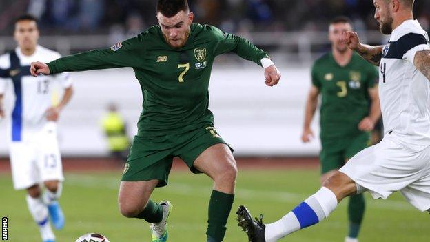 The Republic of Ireland's Aaron Connolly attempts to get past Finland's Joona Toivio