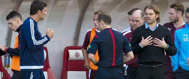 Robbie Neilson remonstrates with Collum in the dugout