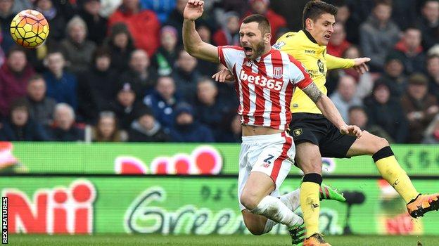 Ashley Westwood brings down Phil Bardsley for a penalty