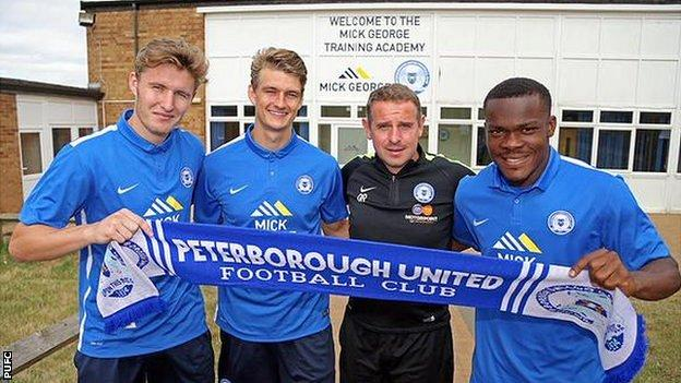 From left: Keiran Sadlier, Andrew Fox, PUFC manager Dave Robertson, Souleymane Coulibaly.