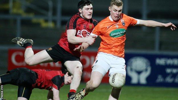 Down defender Jamie Donnan challenges Armagh's Oisin O'Neill in the U21 clash at Pairc Esler