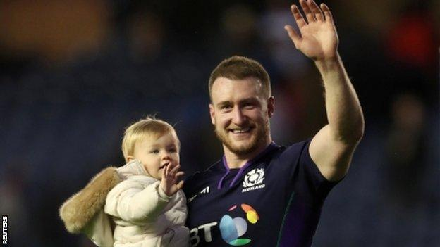 Stuart Hogg celebrates with his daughter after Scotland's win over Fiji
