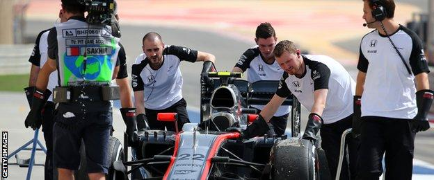 Ever since the start of the season - as seen here in Bahrain with mechanics pushing a car back to the garage- McLaren have suffered with engine issues