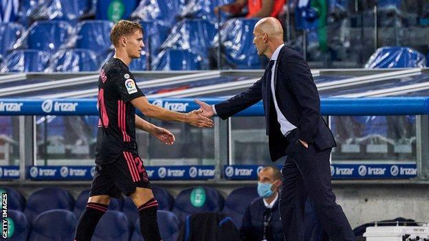 Martin Odegaard shakes hands with Zinedine Zidane