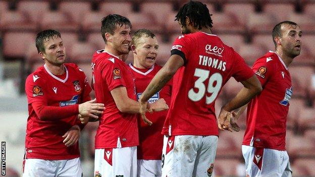 Wrexham players celebrate Luke Young's goal