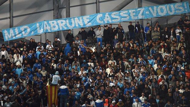Marseille fans with protest banner