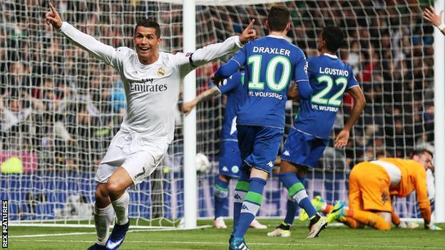 Real Madrid forward Cristiano Ronaldo celebrates scoring against Wolfsburg in the Champions League