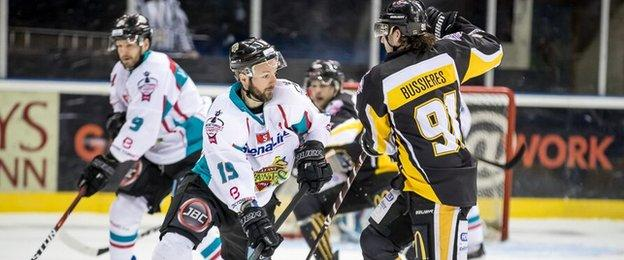 Giants forward Colin Shields attempts to get past Raphael Bussiers at the National Ice Centre