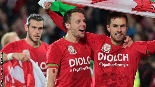 Gareth Bale (left), Chris Gunter (centre) and Aaron Ramsey celebrate Wales' Euro 2016 qualification