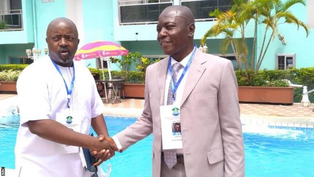 New Sierra Leone Football Association President Thomas Daddy Brima (left) shakes hands with defeated opponent Sadick Deen-Nyarkoh