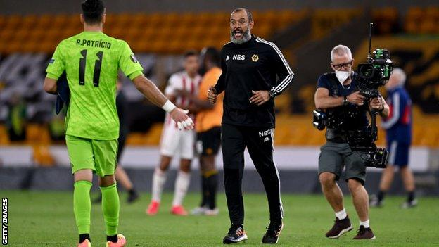 Wolves goalkeeper Rui Patricio is congratulated by his manager Nuno