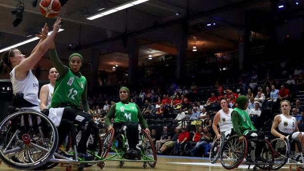 Hamburg, Germany, 16 August: Laura Fuerst of Germany and Kheira Zairi of Algeria battle for the ball during the Women's Wheelchair Basketball World Championships. (Photo by Martin Rose/Bongarts/Getty Images)
