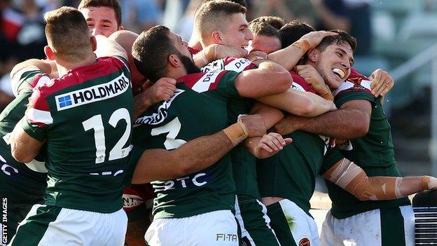 Lebanon players celebrate a try by Mitchell Moses during their 29-18 victory over France in the Rugby League World Cup on Sunday