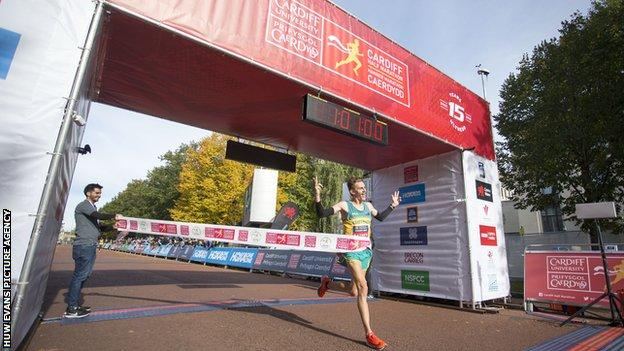 Jack Rayner crosses the finish line in the Cardiff Half Marathon