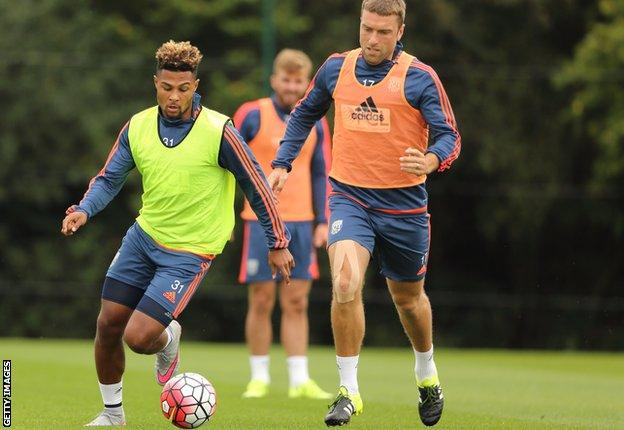 Rickie Lambert and Serge Gnabry of West Bromwich Albion during the West Bromwich Albion training session at West Bromwich Albion Training Ground on August 18, 2015 in Walsall, England