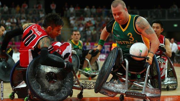 Riley Batt of Australia battles with Canada in wheelchair rugby
