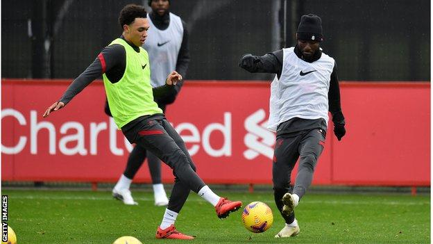 Trent Alexander-Arnold (L) and Naby Keita