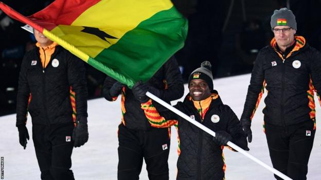 Ghana's flagbearer Akwasi Frimpong leads the delegation as they parade during the opening ceremony