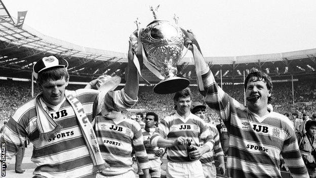 Wigan celebrate with the Challenge Cup