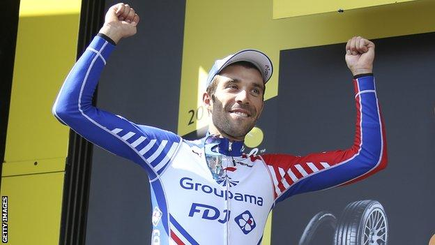Thibaut Pinot celebrates on the podium after winning stage 14