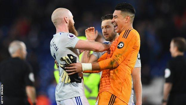 Neil Etheridge celebrates his penalty save
