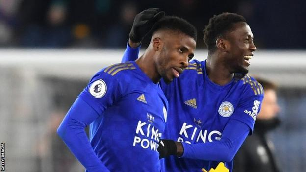 Nigeria team-mates Kelechi Iheanacho (left) and Wilfred Ndidi celebrate a goal for Leicester City