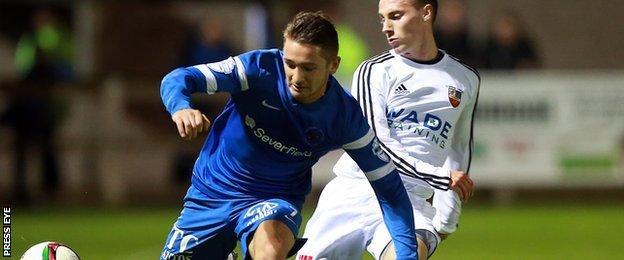 Ballinamallard's Liam Martin in action against Ryan Gourley of Banbridge Town