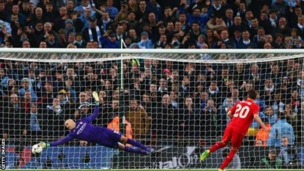 Manchester City keeper Willy Caballero saves Adam Lallana's penalty during the shootout