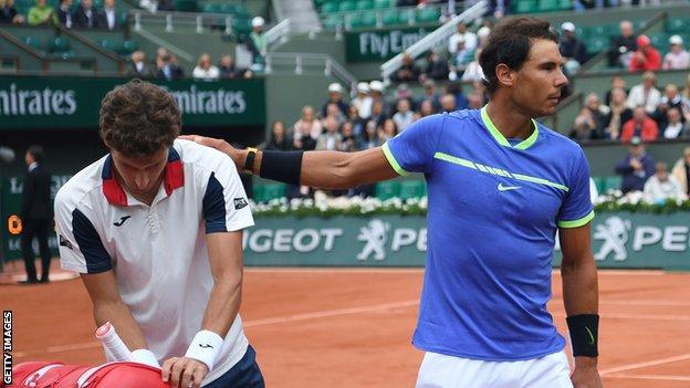 Rafael Nadal consoles fellow Spaniard Pablo Carreno Busta