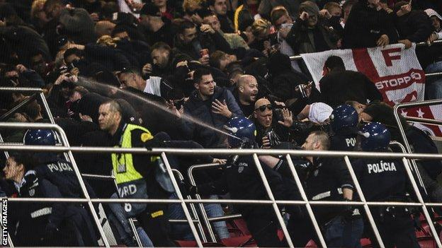 Ajax fans clash with police