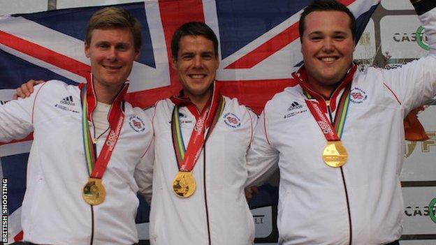 Tim Kneale (centre) celebrates winning the double trap team world title with Matt Coward-Holley and Matt French