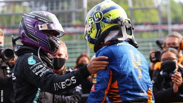 Lewis Hamilton and Lando Norris congratulate each other