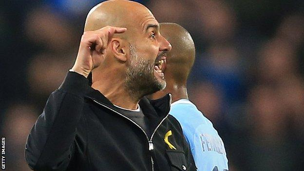 Pep Guardiola pointing to the officials in anger.