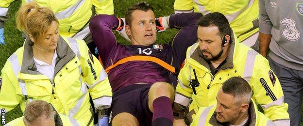 Shay Given is stretched off during the Republic's win over Germany in October