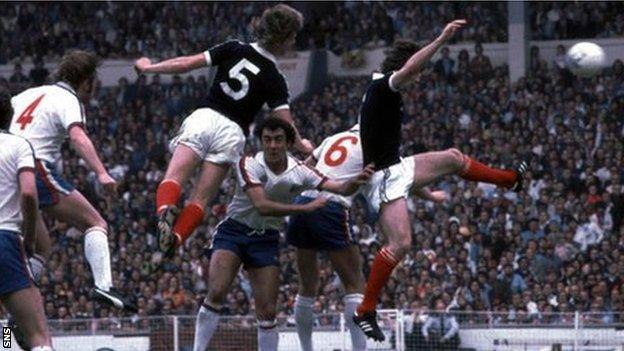 Gordon McQueen scores for Scotland