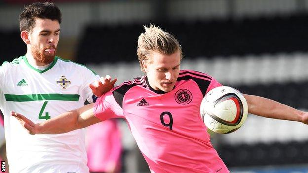 Liam Donnelly takes on Jason Cummings during a Northern Ireland v Scotland under-21 international