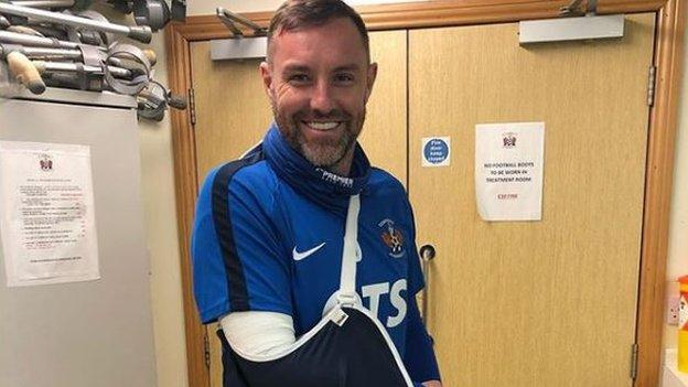 Kris Boyd with his arm in a sling