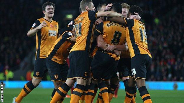 Hull City players celebrate scoring a goal